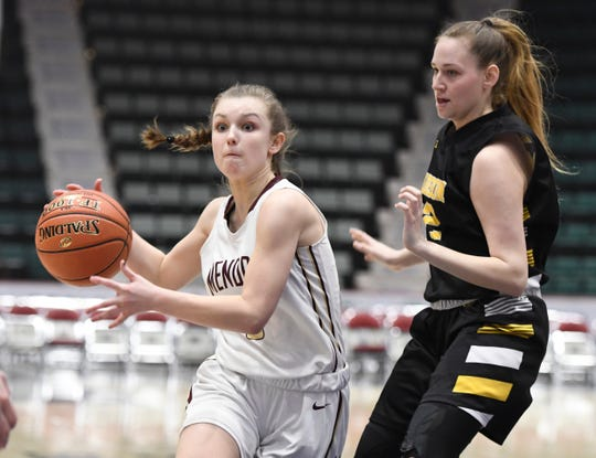 Pittsford Mendon's Courtney Naugle pushes toward the hoop past James Madison's Erika James during their Girls Class A Federation Tournament of Champions semifinal at Cool Insuring Arena on Friday, March 23, 2019, in Glens Falls.