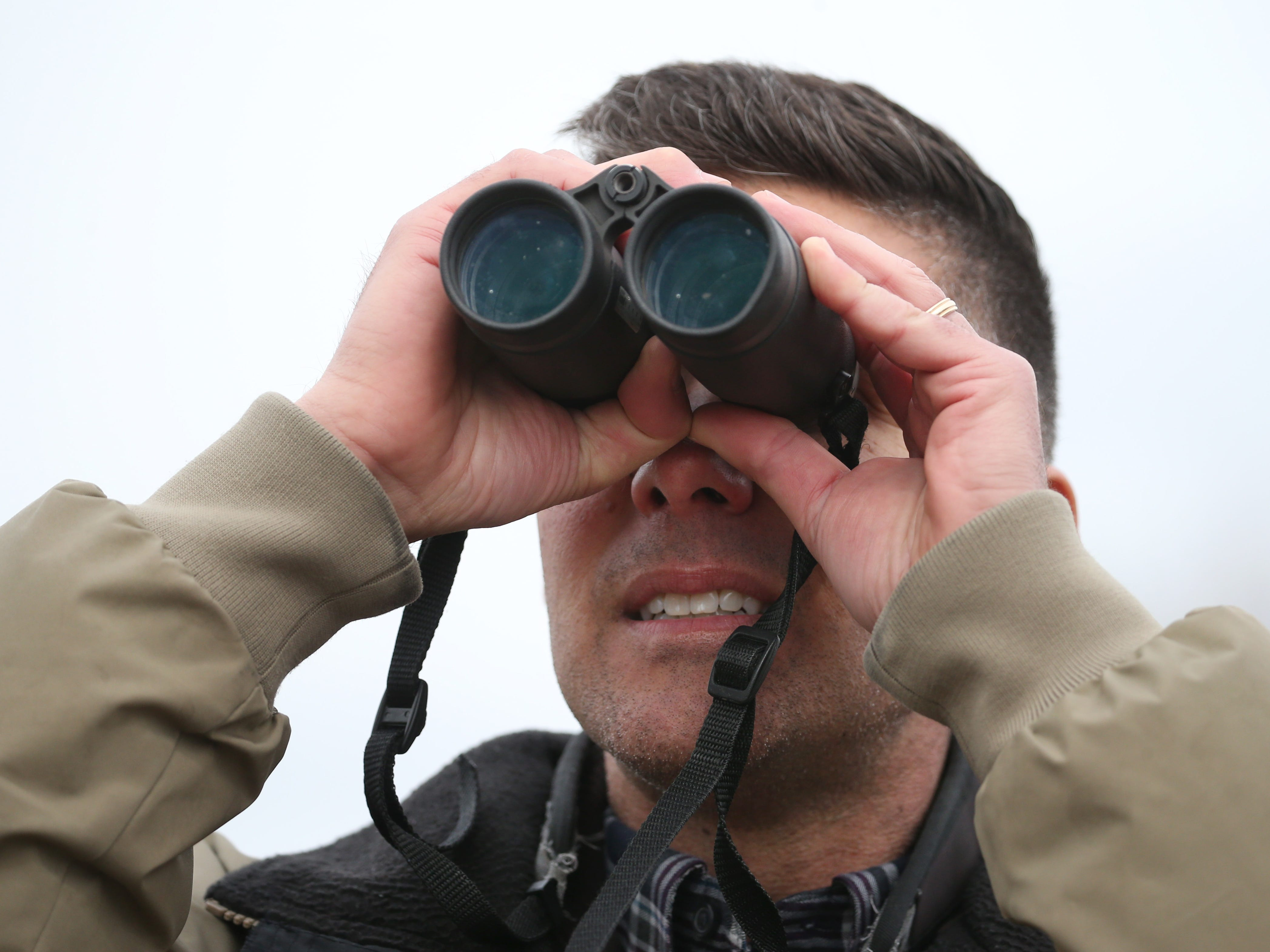 Chris Lajewski, Montezuma Audubon Center Director, scans the tree line looking for eagles during the annual spring migration at the Montezuma Wetlands Complex in Savannah Thursday, March 21, 2019.  The complex is home to twelve active bald eagle nests.