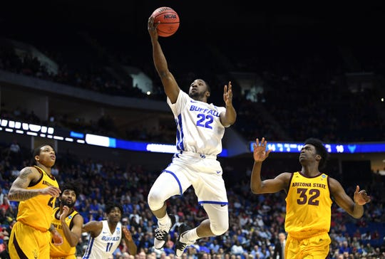 TULSA, OKLAHOMA - MARCH 22:  Dontay Caruthers #22 of the Buffalo Bulls lays up against De'Quon Lake #32 of the Arizona State Sun Devils during the first half of the first round game of the 2019 NCAA Men's Basketball Tournament at BOK Center on March 22, 2019 in Tulsa, Oklahoma. (Photo by Harry How/Getty Images)