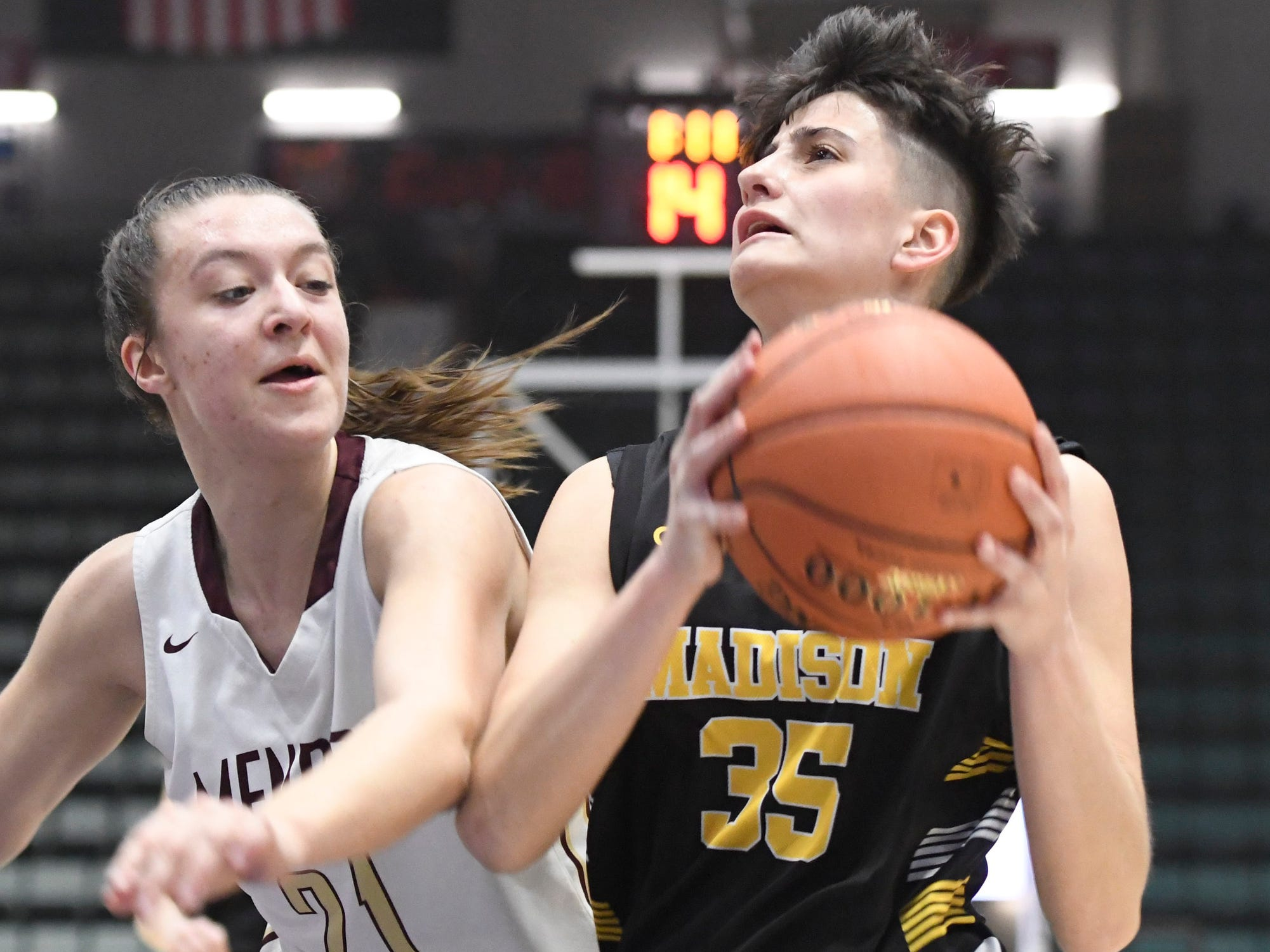 Pittsford Mendon's Alana Fursman attempts to snatch the ball from James Madison's Melinda Feratovic during their Girls Class A Federation Tournament of Champions semifinal at Cool Insuring Arena on Friday, March 23, 2019 in Glens Falls.