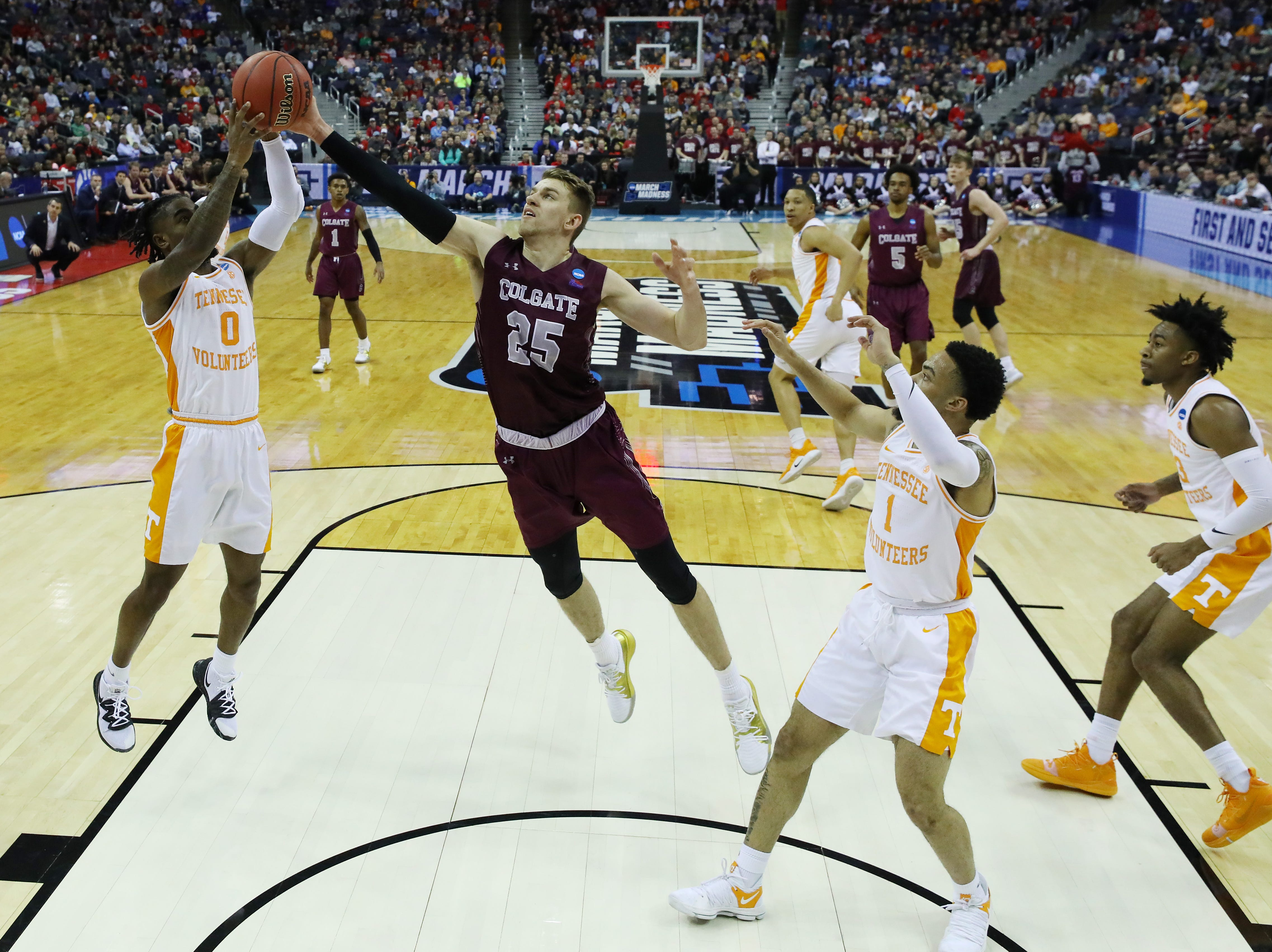 COLUMBUS, OHIO - MARCH 22: Jordan Bone #0 of the Tennessee Volunteers battles for the ball with Rapolas Ivanauskas #25 of the Colgate Raiders during the first half in the first round of the 2019 NCAA Men's Basketball Tournament at Nationwide Arena on March 22, 2019 in Columbus, Ohio. (Photo by Elsa/Getty Images)