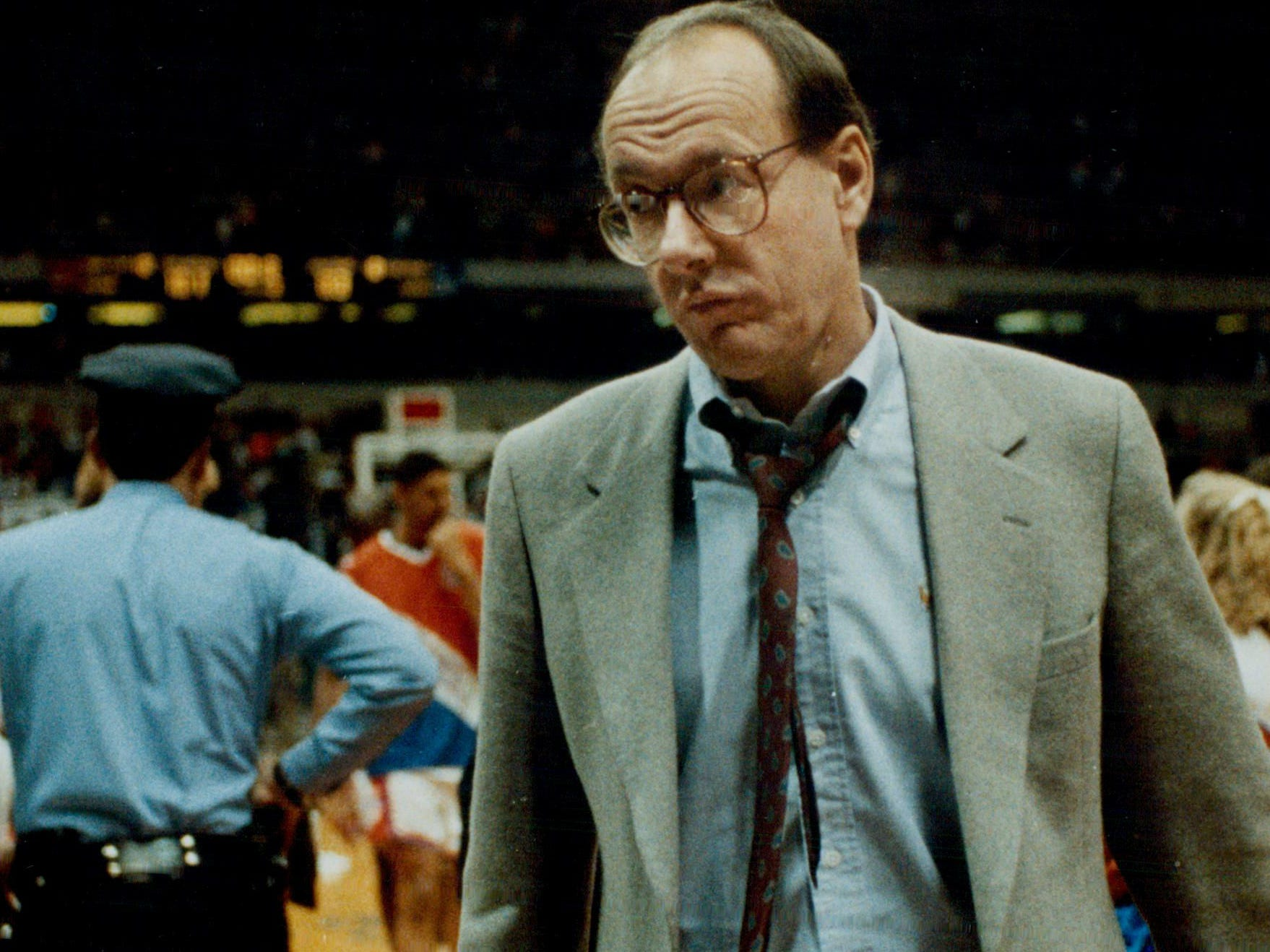 Jim Boeheim exits the Carrier Dome court after a 101-83 win over Providence on Feb. 12, 1991.