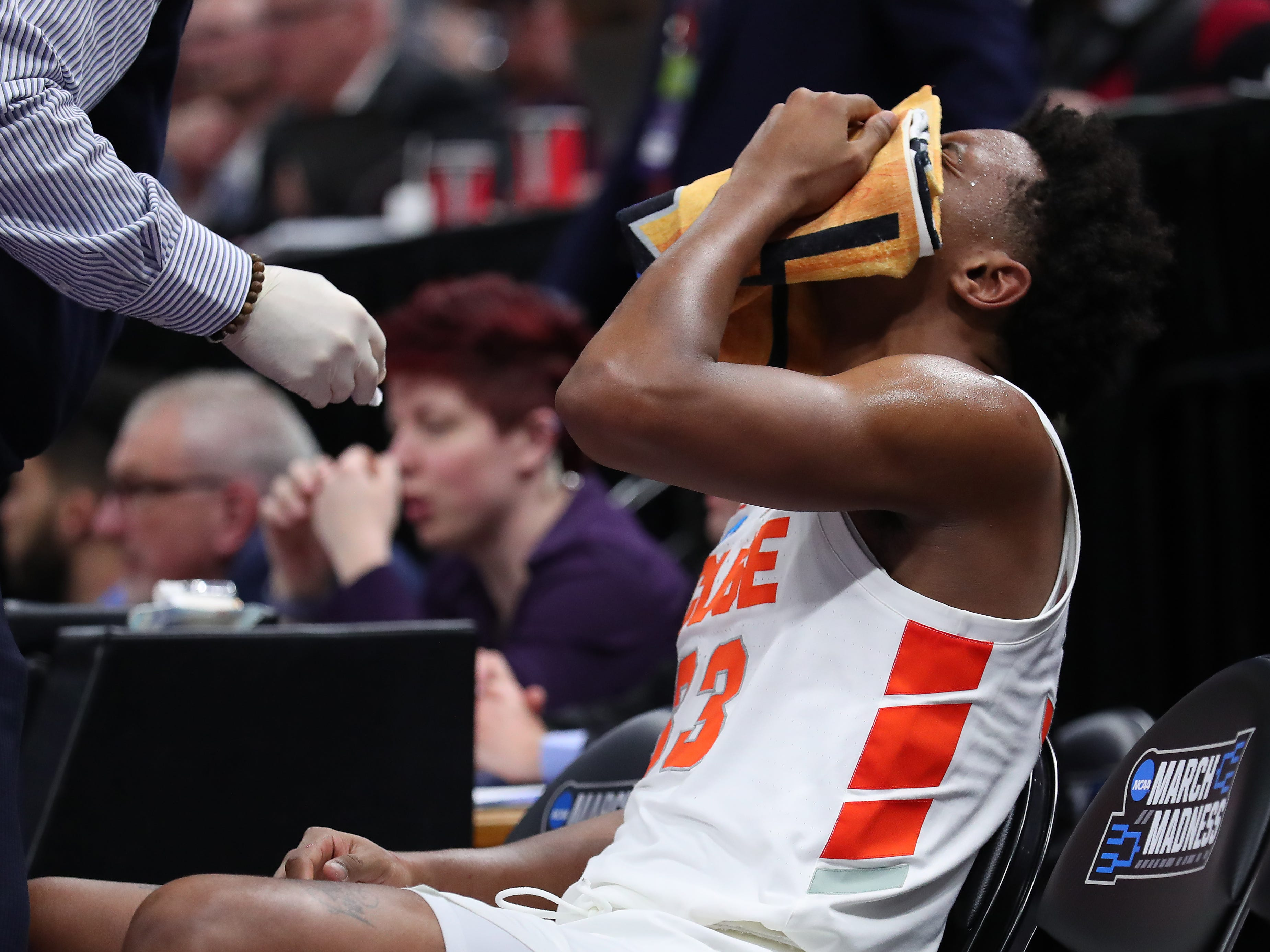 Elijah Hughes of the Syracuse Orange sits on the bench after getting hit in the face by Freddie Gillespie of the Baylor Bears during the second half in the first round of the 2019 NCAA Men's Basketball Tournament at Vivint Smart Home Arena on March 21, 2019 in Salt Lake City, Utah. Hughes scored 25 points, but Syracuse lost, 78-69.