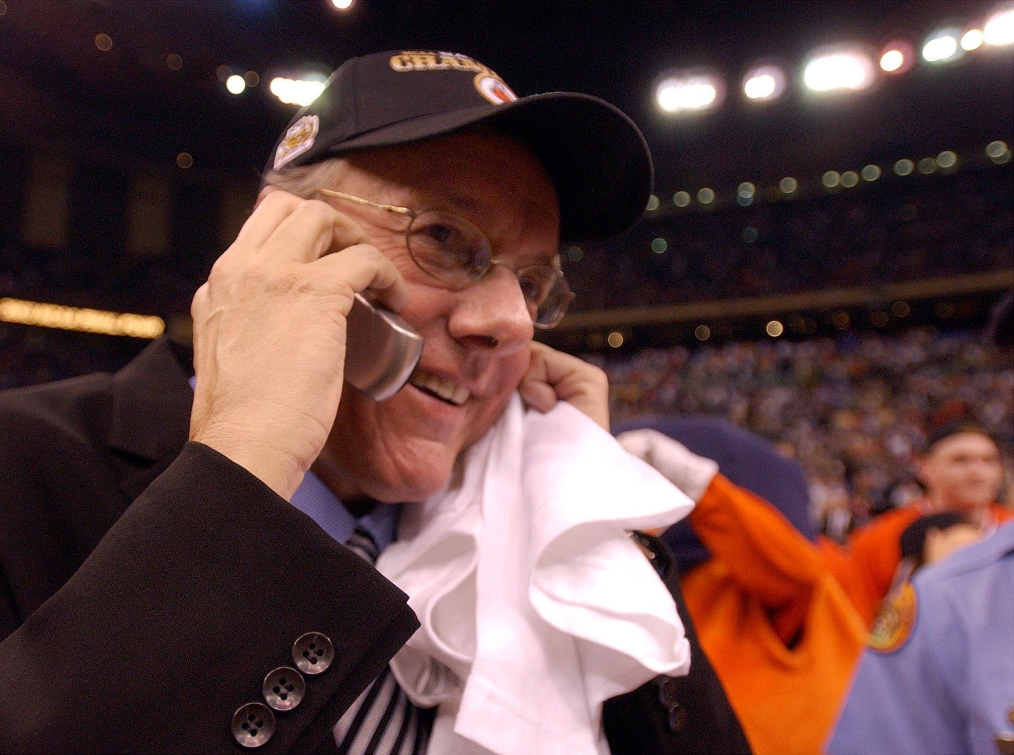 Syracuse head coach Jim Boeheim takes a call following the Orangemen's 81-78 win over Kansas in the 2003 national championship game.