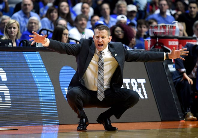 Buffalo coach reacts from the sidelines during his team's game against Arizona State during the first round of the 2019 NCAA tournament.