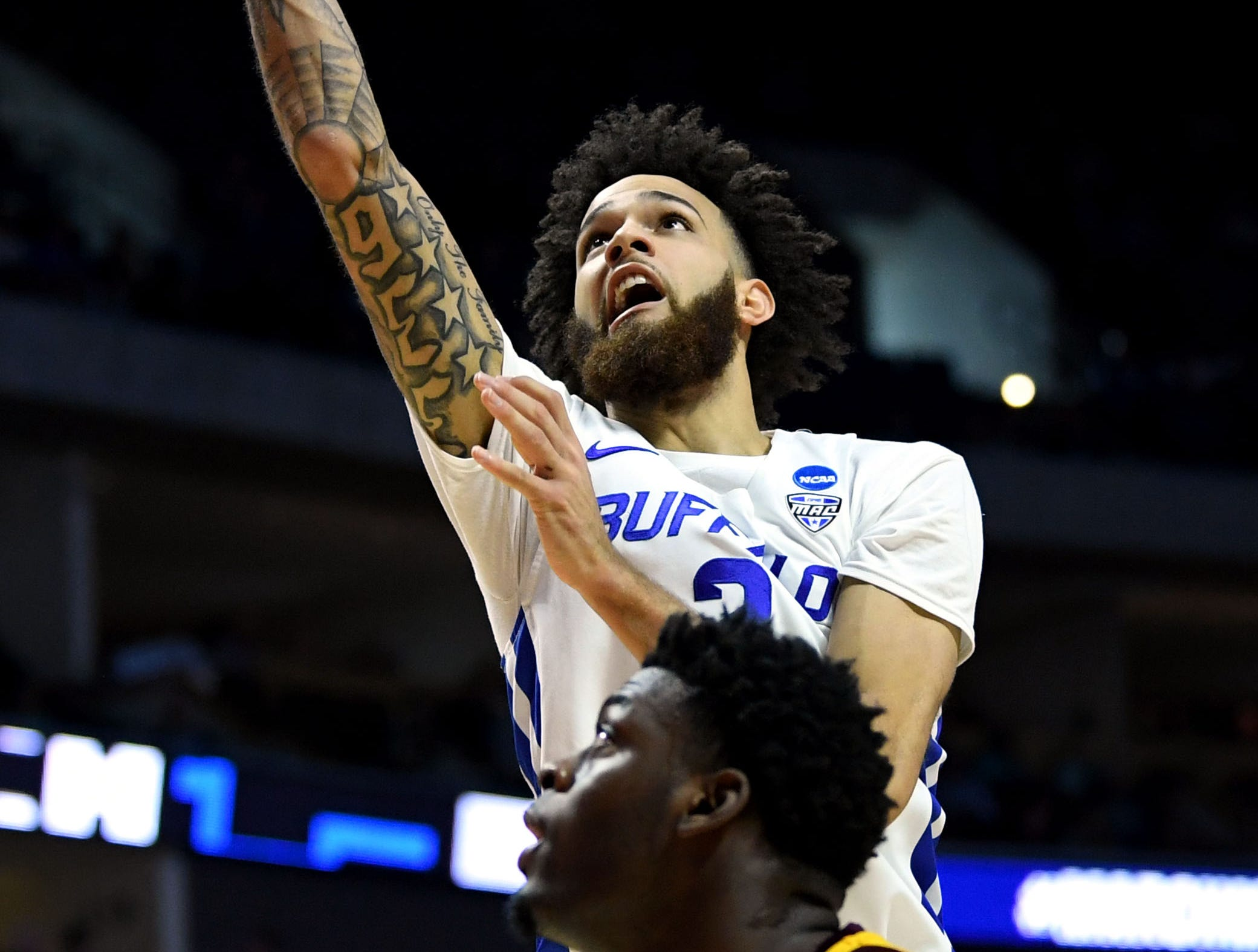 TULSA, OKLAHOMA - MARCH 22:  Jeremy Harris #2 of the Buffalo Bulls scores on a lay up in front of Luguentz Dort #0 of the Arizona State Sun Devils during the first half of the first round game of the 2019 NCAA Men's Basketball Tournament at BOK Center on March 22, 2019 in Tulsa, Oklahoma. (Photo by Harry How/Getty Images)