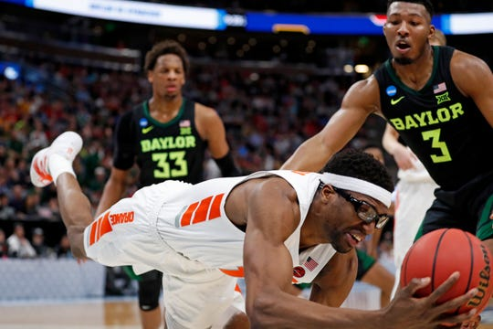 Syracuse center Paschal Chukwu, left, dives for the ball in front of Baylor guard King McClure (3) during the second half of a first-round game in the NCAA men's college basketball tournament Thursday, March 21, 2019, in Salt Lake City.