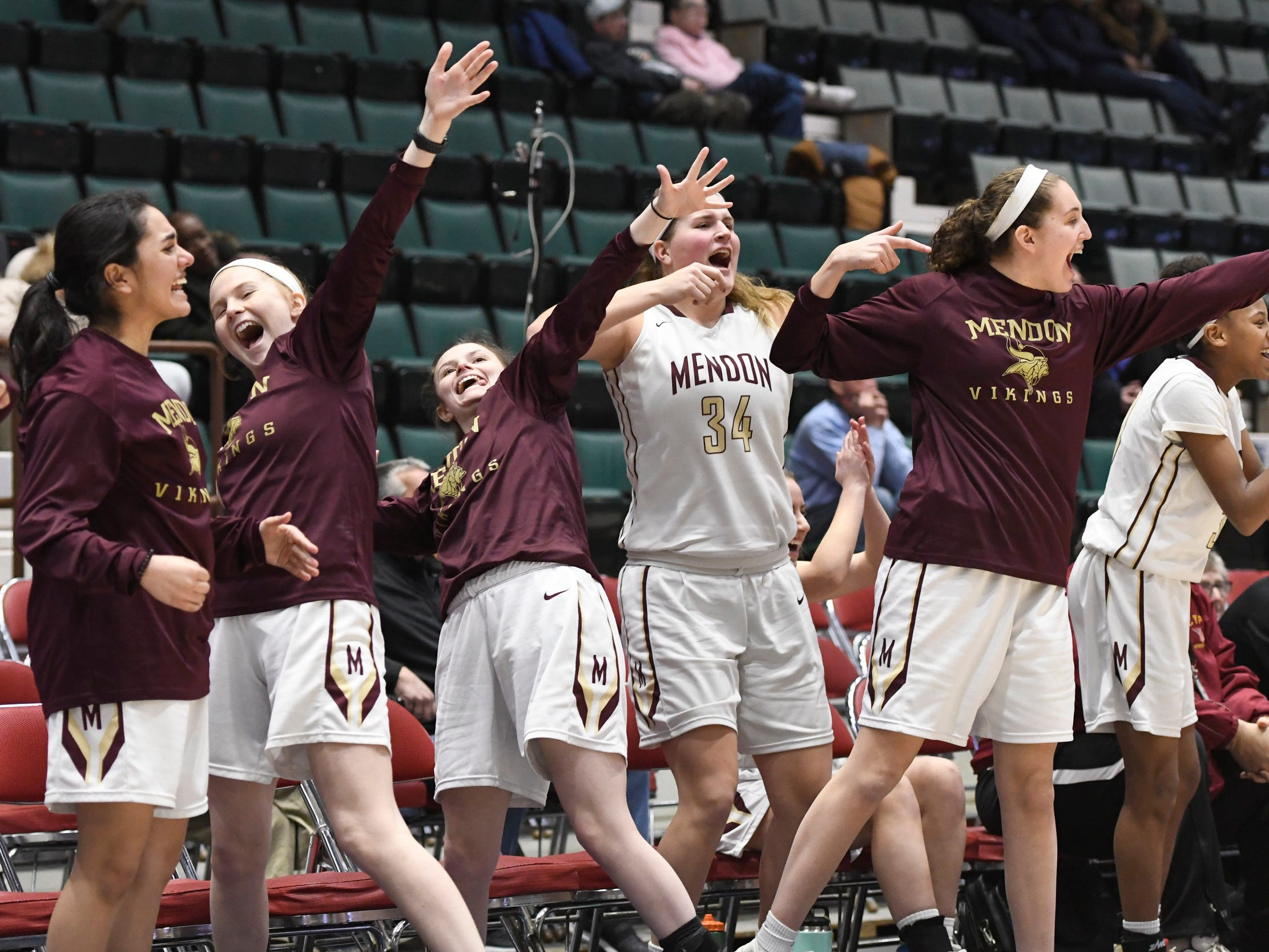 Pittsford Mendon basketball players cheer following a three-pointer scored against James Madison to come within one point of their opponents in the fourth quarter of their Girls Class A Federation Tournament of Champions semifinal at Cool Insuring Arena on Friday March 23, 2019, in Glens Falls.