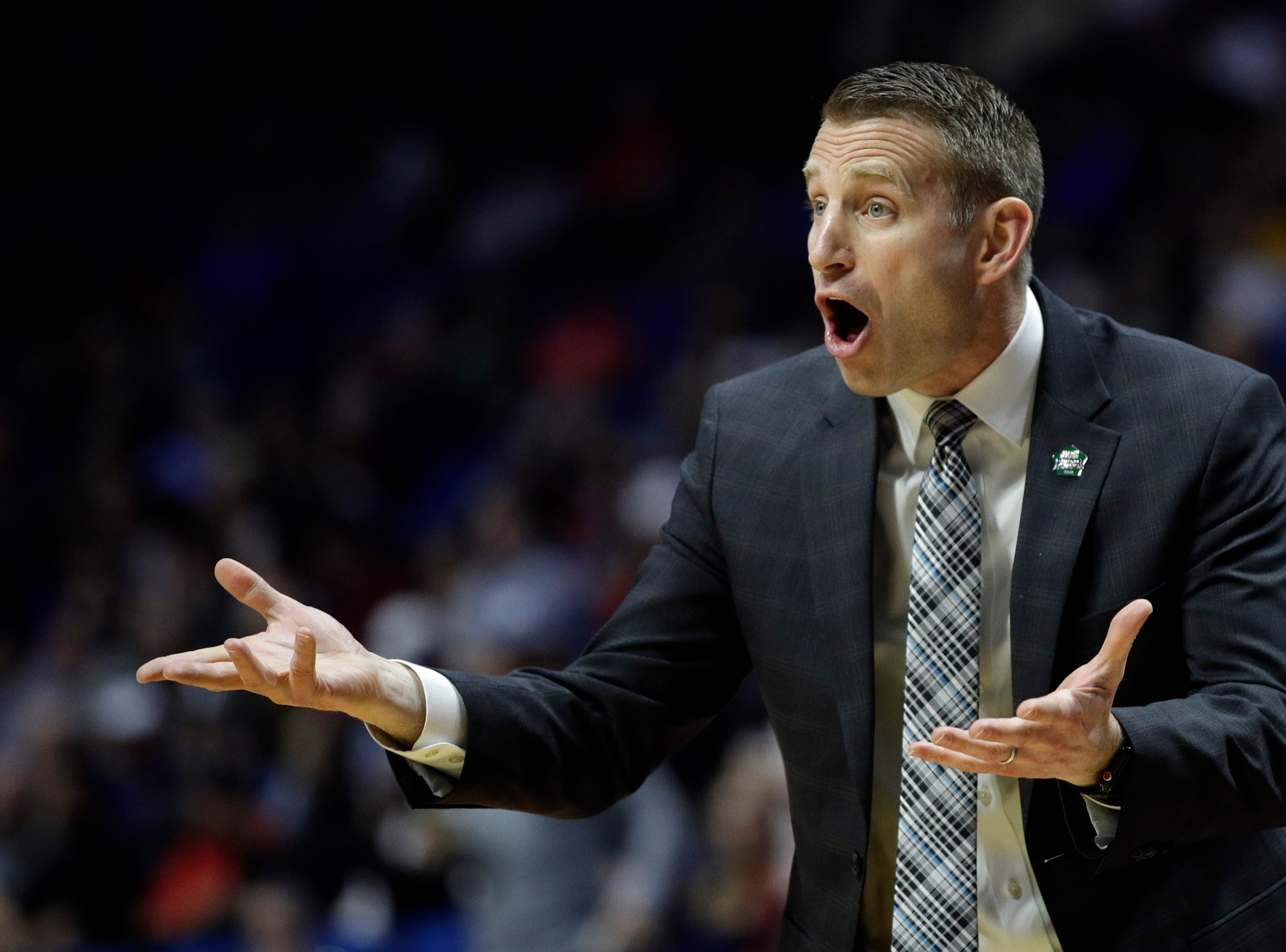 Buffalo head coach Nate Oats talks to his players during the first half of a first round men's college basketball game against Arizona State in the NCAA Tournament Friday, March 22, 2019, in Tulsa, Okla. (AP Photo/Charlie Riedel)