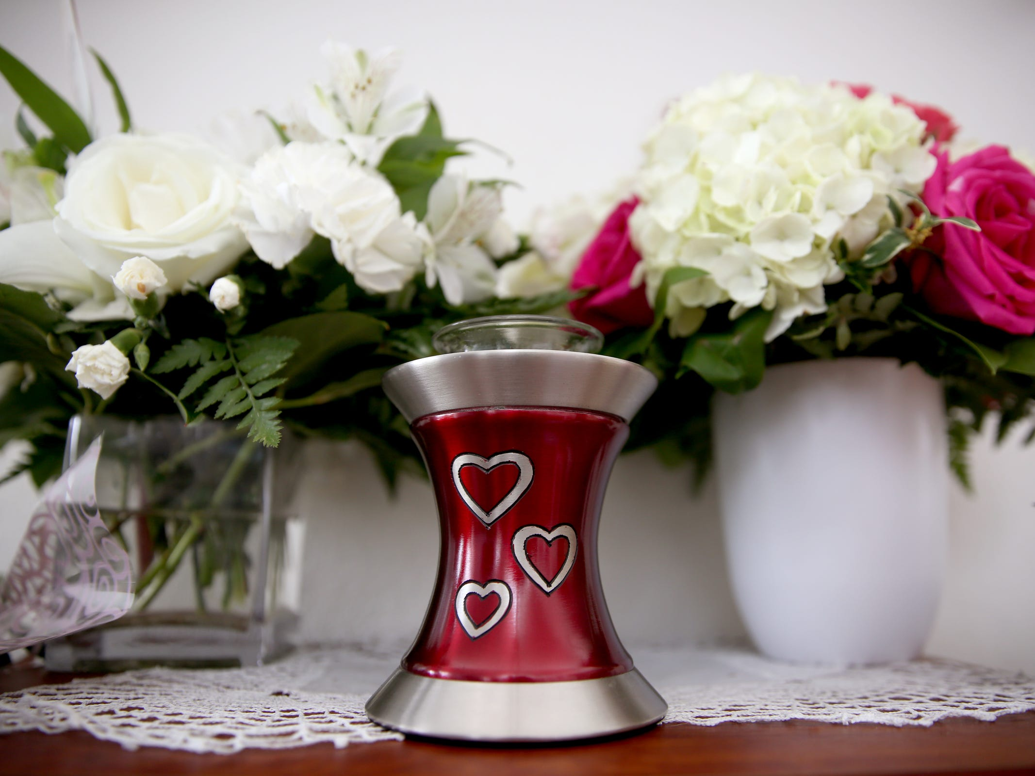 The urn for 7-week-old Evianna Quintero-McCall sits at her parents' home in West Salem on March 22, 2019. She died of meningitis on Sunday after being discharged from the Salem Hospital emergency room with a fever.