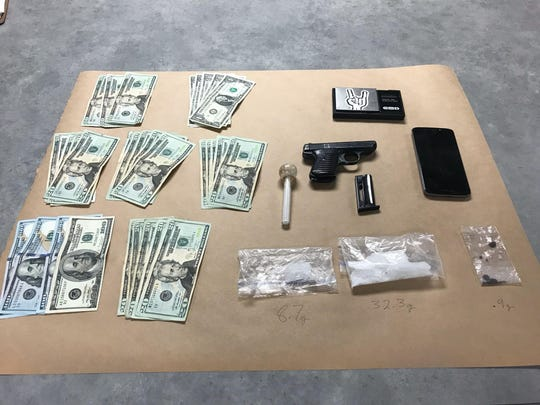 Drugs, a gun and cash were found in a suspect's car after K9 Jack alerted officers of the presence of narcotics.