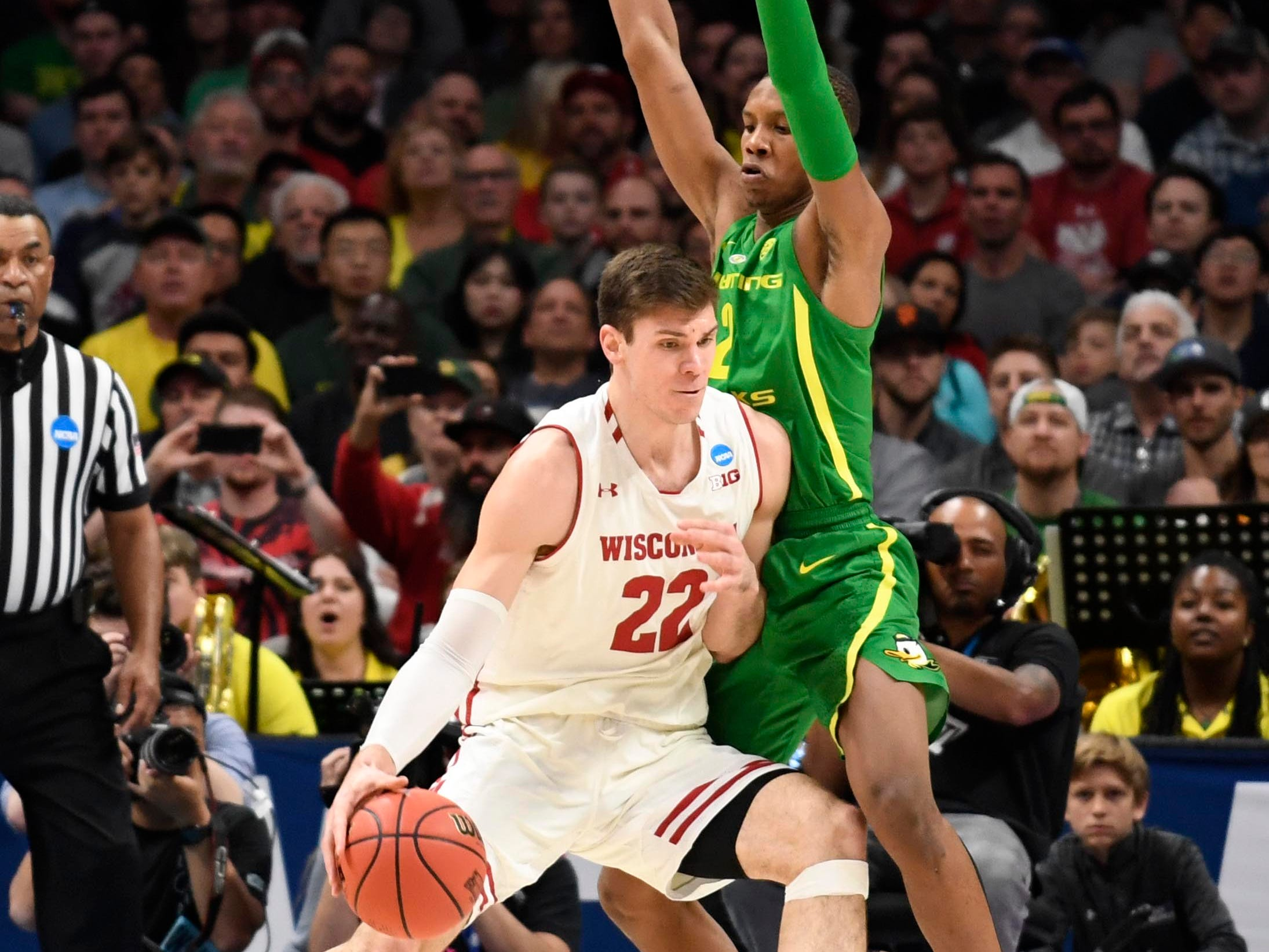 Mar 22, 2019; San Jose, CA, USA; Wisconsin Badgers forward Ethan Happ (22) drives around Oregon Ducks forward Louis King (2) during the first half in the first round of the 2019 NCAA Tournament at SAP Center. Mandatory Credit: Kelley L Cox-USA TODAY Sports
