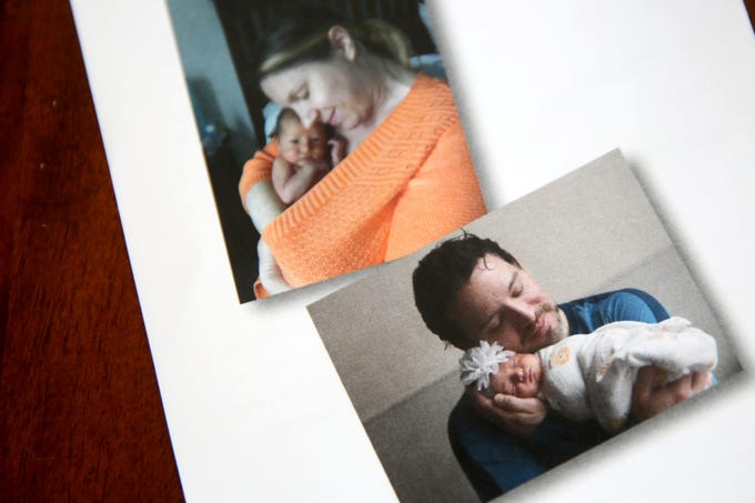 Photographs are printed on a memorial service program of Ginger McCall's 7-week-old daughter, Evianna Quintero-McCall, who died of meningitis on Sunday after being discharged from the Salem Hospital emergency room with a fever. Photographed at her home in West Salem on March 22, 2019.