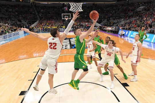 Mar 22, 2019; San Jose, CA, USA; Oregon Ducks guard Payton Pritchard (3) shoots as Wisconsin Badgers forward Ethan Happ (22) and forward Nate Reuvers (35) during the first half in the first round of the 2019 NCAA Tournament at SAP Center. Mandatory Credit: Kyle Terada-USA TODAY Sports