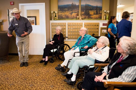Bob Taylor, of Oregon Dream Ponies, tells stories to residents at Prestige Senior Living Southern Hills in Salem on March 21, 2019.