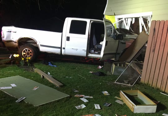 A Woodburn man was arrested early Friday morning on drunk driving and assault charges after driving a pickup truck into an apartment complex, according to the Woodburn Police Department.