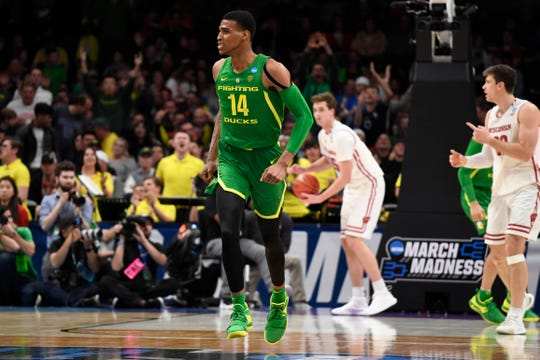 Mar 22, 2019; San Jose, CA, USA; Oregon Ducks forward Kenny Wooten (14) reacts after a dunk during the second half in the first round of the 2019 NCAA Tournament against the Wisconsin Badgers at SAP Center. Mandatory Credit: Kelley L Cox-USA TODAY Sports