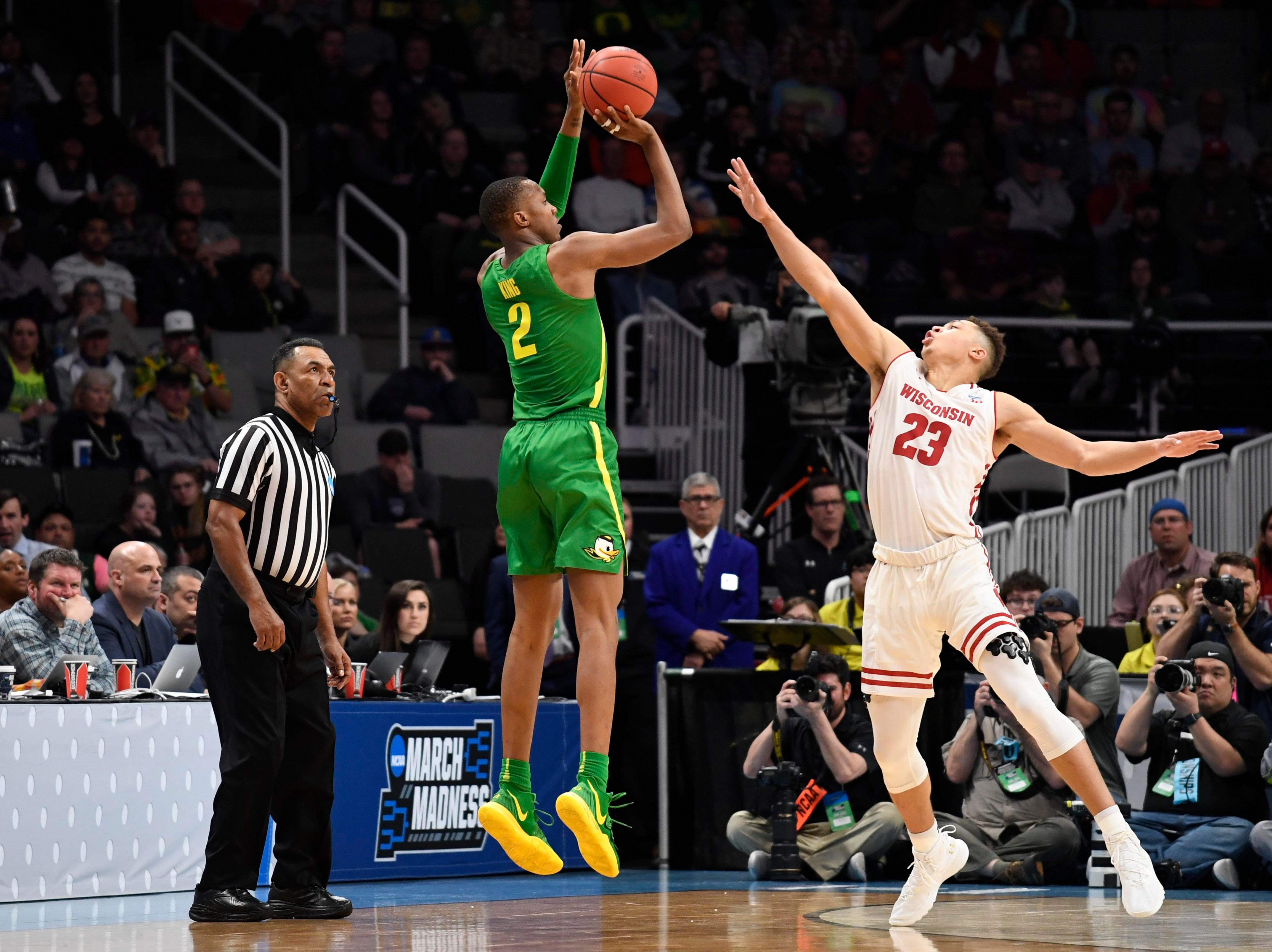 Mar 22, 2019; San Jose, CA, USA; Oregon Ducks forward Louis King (2) shoots as Wisconsin Badgers guard Kobe King (23) defends during the second half in the first round of the 2019 NCAA Tournament at SAP Center. Mandatory Credit: Kelley L Cox-USA TODAY Sports