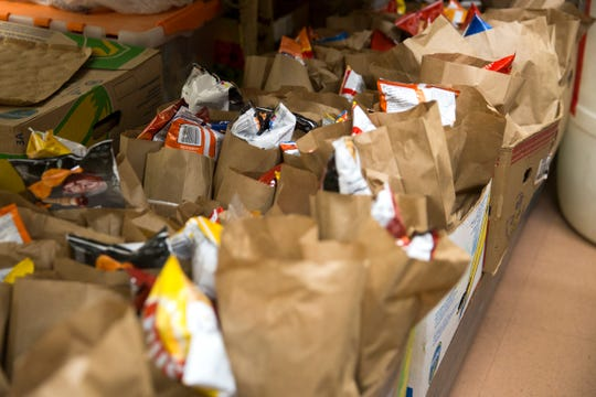 Bagged lunches, given to ARCHES, are prepared at St. Vincent de Paul food bank in Salem on March 21, 2019. The food bank makes around 25,000 sack lunches a year.