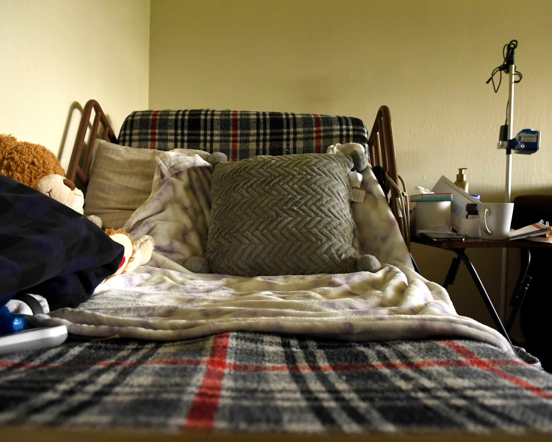 Gloria Torrez was diagnosed with stomach cancer, and as she became more ill, she has stayed in this bed at her Salinas home.