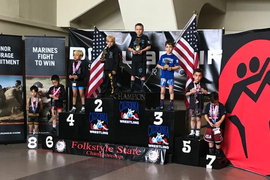 Salinas native Casey Bittner (center, top step) won his second consecutive state championship this month and heads to the national championships next weekend in Iowa.