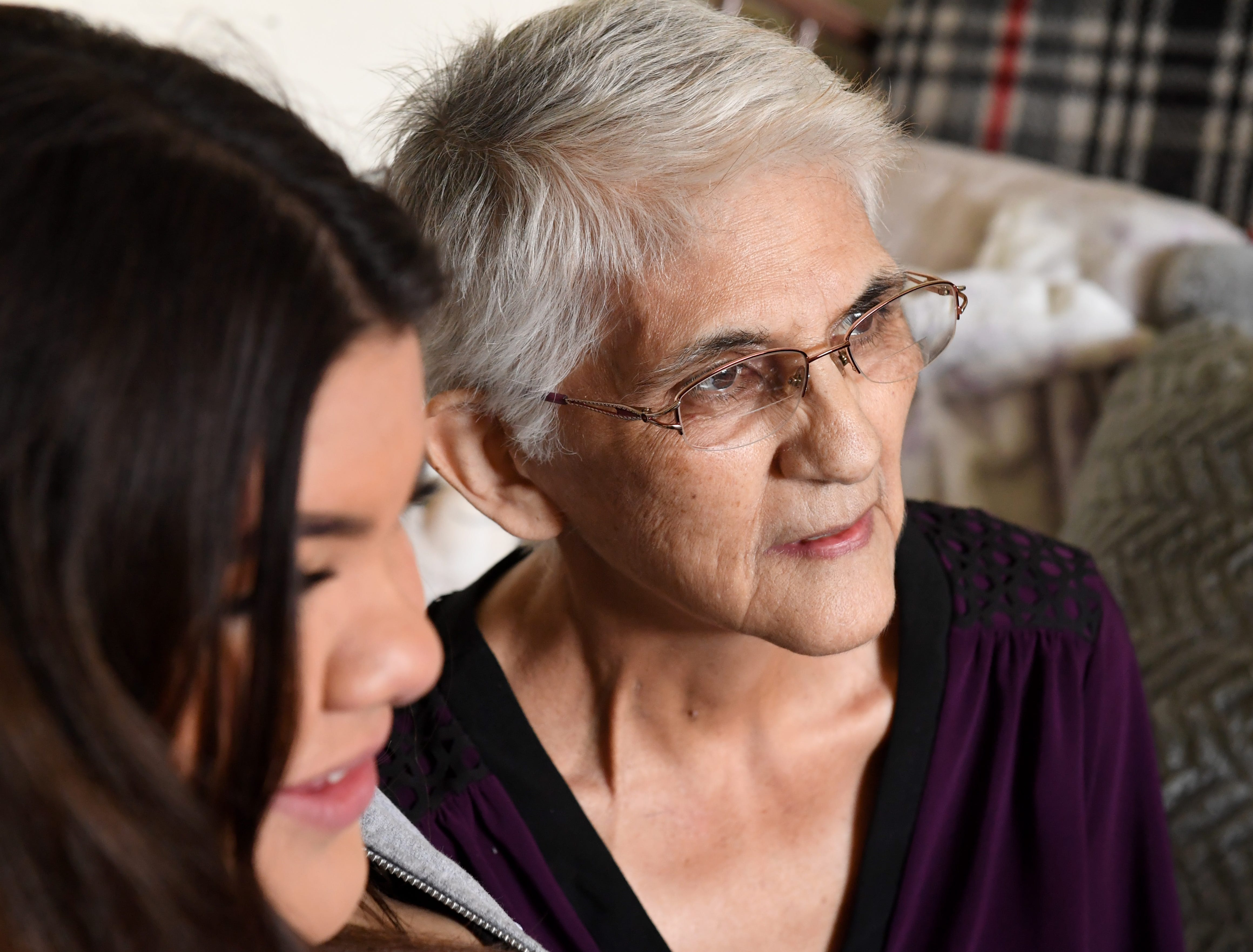 Gloria Torrez  (right) sits with her granddaughter and namesake Gloria at her Salinas home in March 2019l.