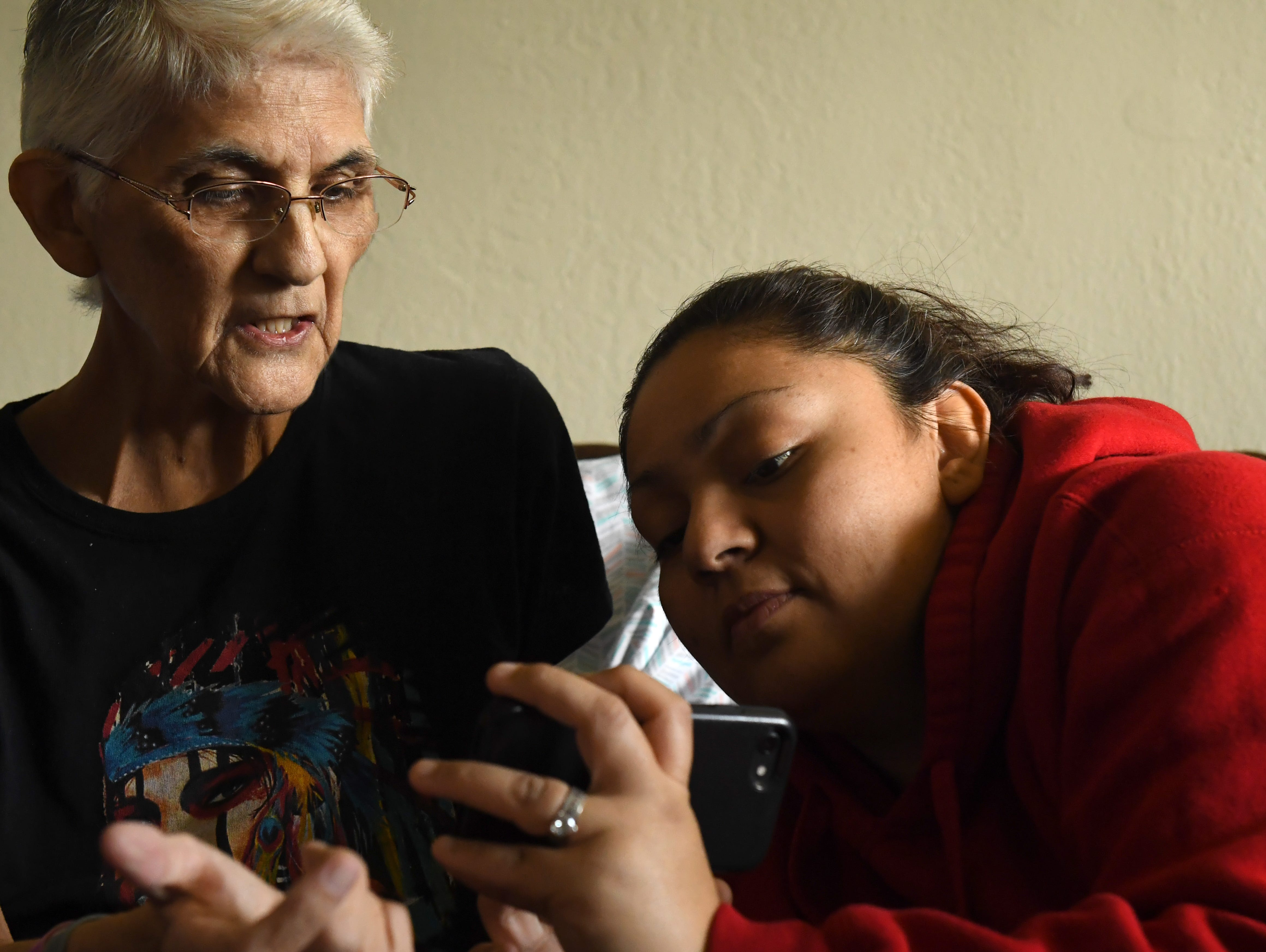 Gloria Torres looks at a phone with her daughter Yolanda Torrez at her Salinas home in March 2019.