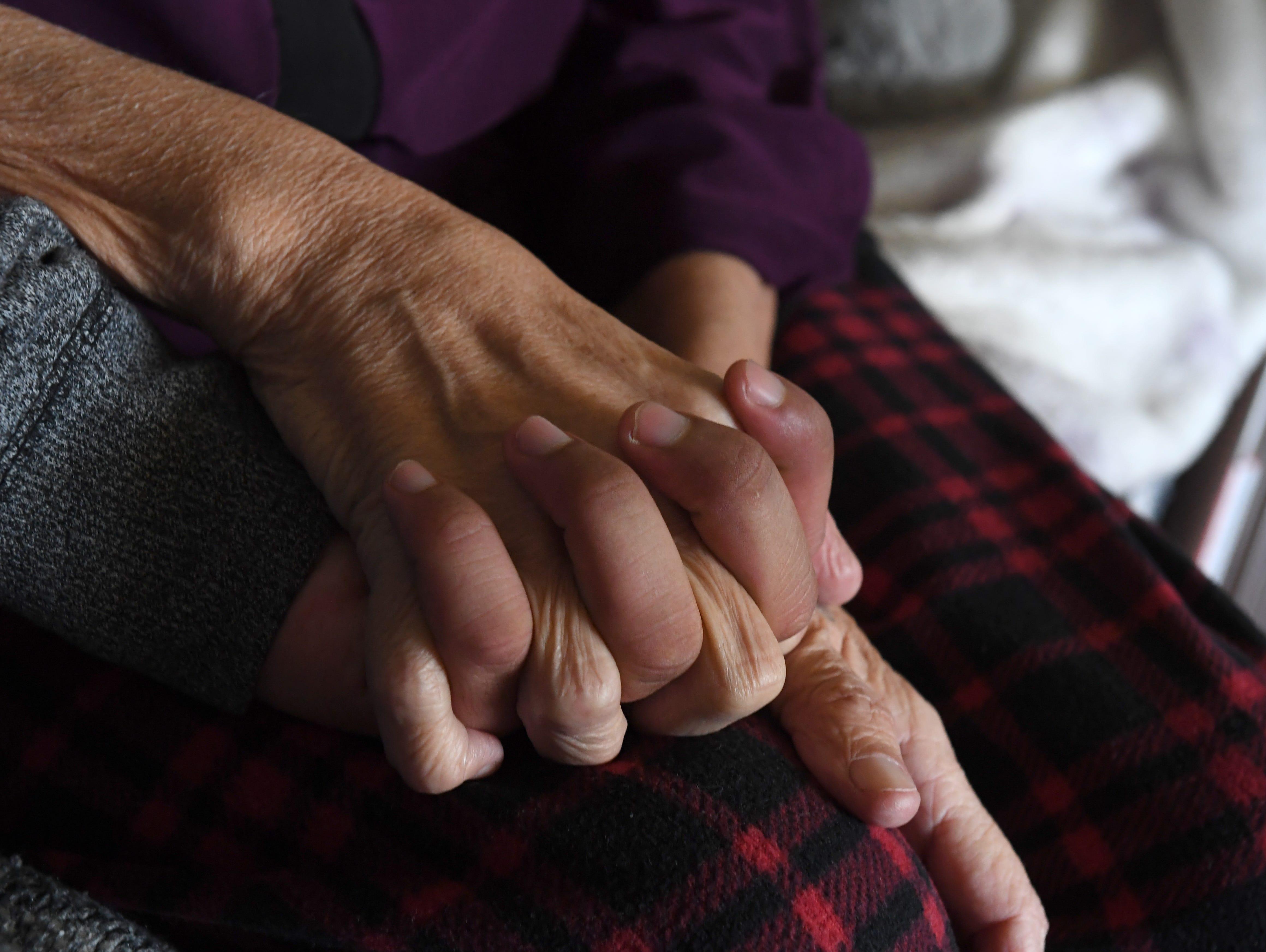 "Paul ""Little Paul"" Torrez holds hands with his grandmother Gloria Torrez."