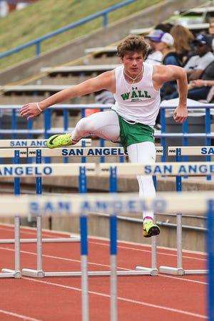 Wall's Drake Holifield runs the hurdles during the San Angelo Relays Friday, March 22, 2019, at the San Angelo Stadium.
