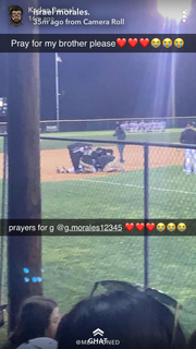 A copy of a Snapchat photo taken by a fan at the Brady-Sonora baseball game Tuesday, March 19, 2019, at the Brady baseball facility. Brady athletic trainers and coaches attend to Gonzalo Morales, who was knocked unconscious following a collision with Sonora base runner Hunter Bunch. According to Brady head baseball coach Rocky Bernal, Morales is lying just inside the grass that separates the third-base area from the pitcher's mound.