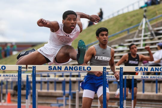 Runners jump hurdles during the San Angelo Relays Friday, March 22, 2019, at the San Angelo Stadium.