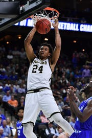 Mar 21, 2019; Jacksonville, FL, USA; Wofford Terriers forward Keve Aluma (24) dunks the ball in front of Seton Hall Pirates forward Michael Nzei (1) during the first half in the first round of the 2019 NCAA Tournament at Jacksonville Veterans Memorial Arena. Mandatory Credit: John David Mercer-USA TODAY Sports