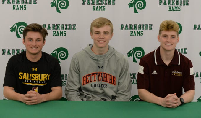 L-R: Parkside's Kade Johnson, Michael Daugherty and Mark Zimmerman announce their intent to take part in athletics at the college level on Friday, March 22, 2019.