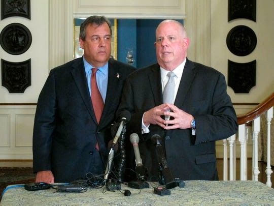 Maryland Gov. Larry Hogan, right, talks to reporters with former New Jersey Gov. Chris Christie on Thursday, March 21, at the governor's residence in Annapolis.