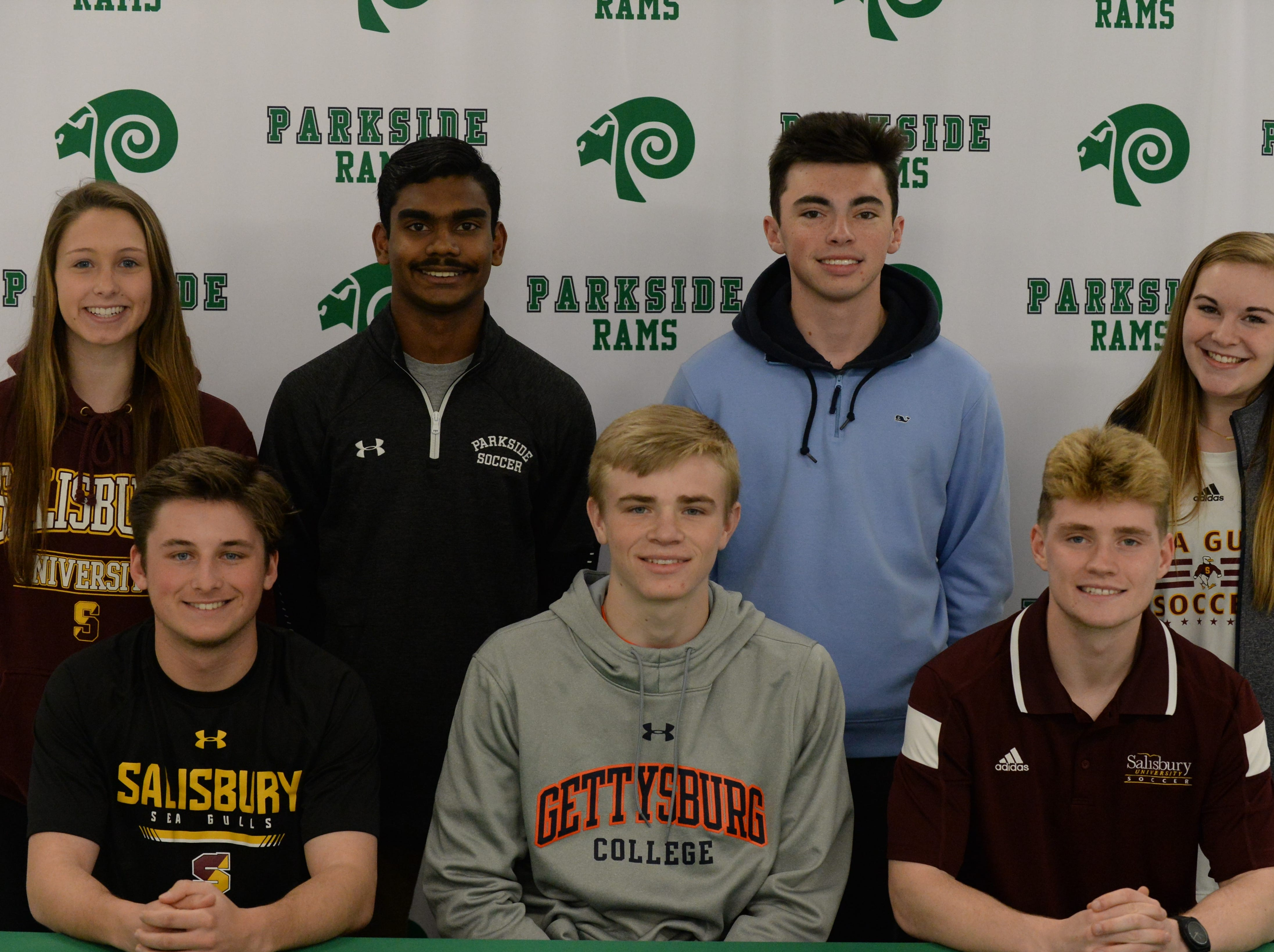 L-R (Sitting) Parkside's Kade Johnson, Michael Daugherty and Mark Zimmerman announce their intent to take part in athletics at the college level on Friday, March 22, 2019.