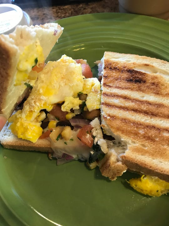 A huevos rancheros breakfast sandwich at Daydream Cafe in Sheboygan Falls.