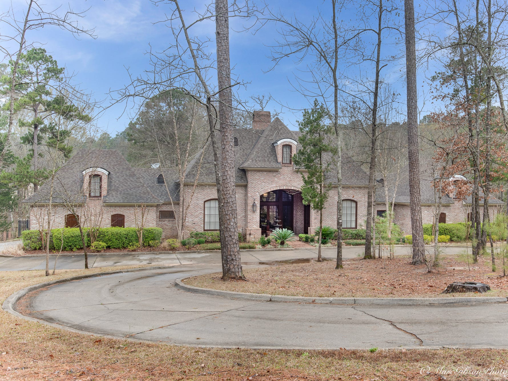 1026 Ellerbe Court, Shreveport  Price: $1,195,000  Details: 4 bedrooms, 5 baths, 5,834 square feet  Features: South Shreveport living on 4.2 acres with arched brick accent walls and wooden beams, iron work, chef's dream kitchen with Wolf gas cooktop and built-in refrigerator, living room with 24 ft. ceilings, luxurious master suite with fireplace overlooking grounds, lower level with mini kitchen/office/den.  Contact: Lynn Roos, 455-6004