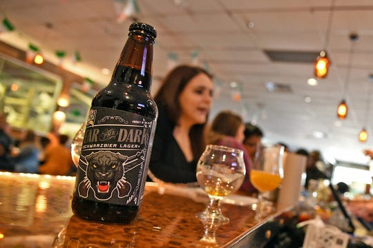 A bottle of Red River Brewing Company's Fear the Dark, a dark, refreshing German lager with notes of coffee and chocolate, sits on the brewery bar in Shreveport, Louisiana, March 16, 2019.