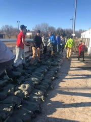 Over 100 volunteers showed up on multiple nights last week to fill sandbags around the Brandon hockey ring, home of the Ice Cats.