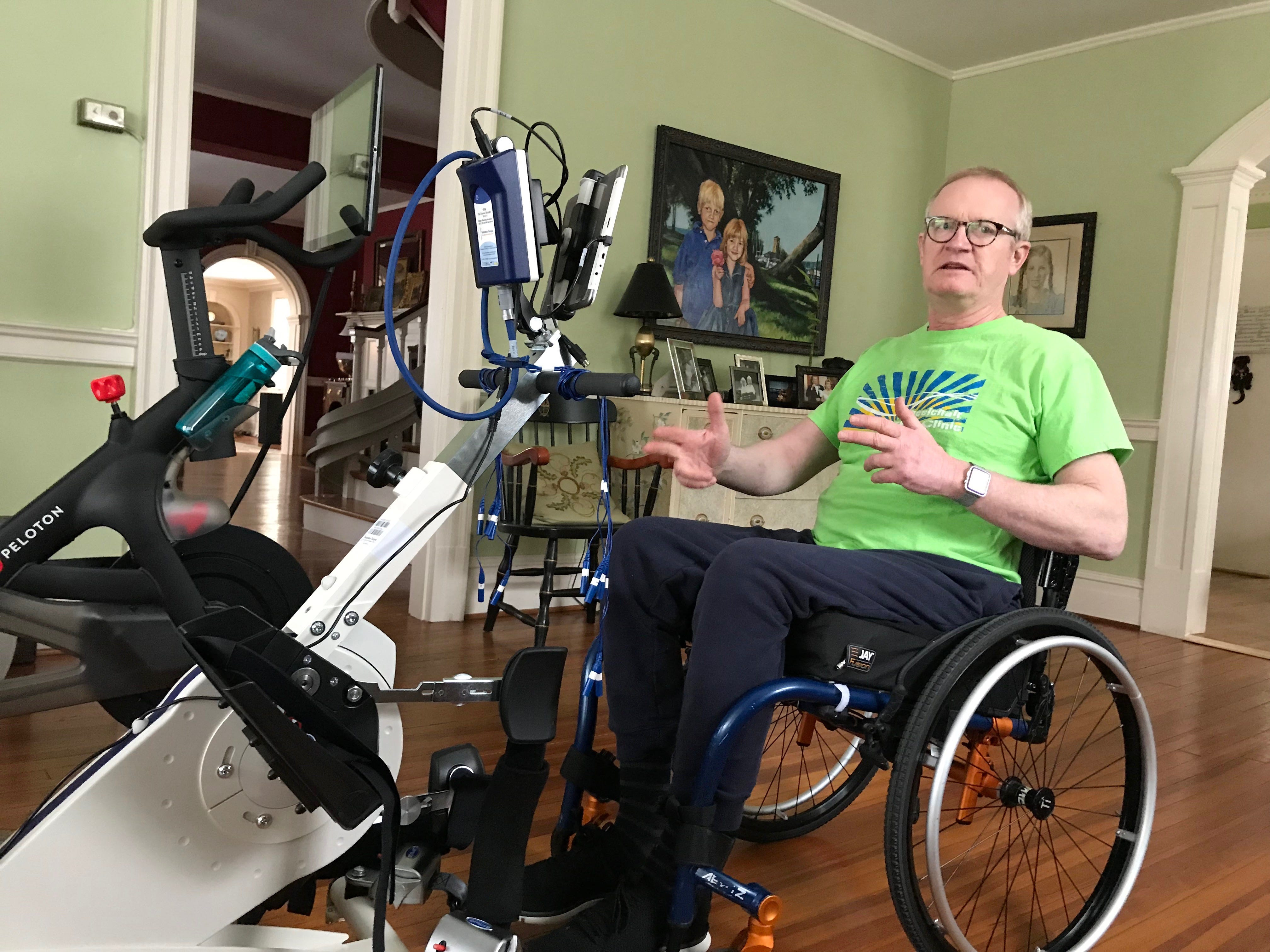 Dr. Robert Kyler uses an electrical stimulation bike (e-stim bike) to improve circulation and reduce muscle atrophy in his legs. Photographed in his home in Staunton, Virginia, on Friday, March 8, 2019.
