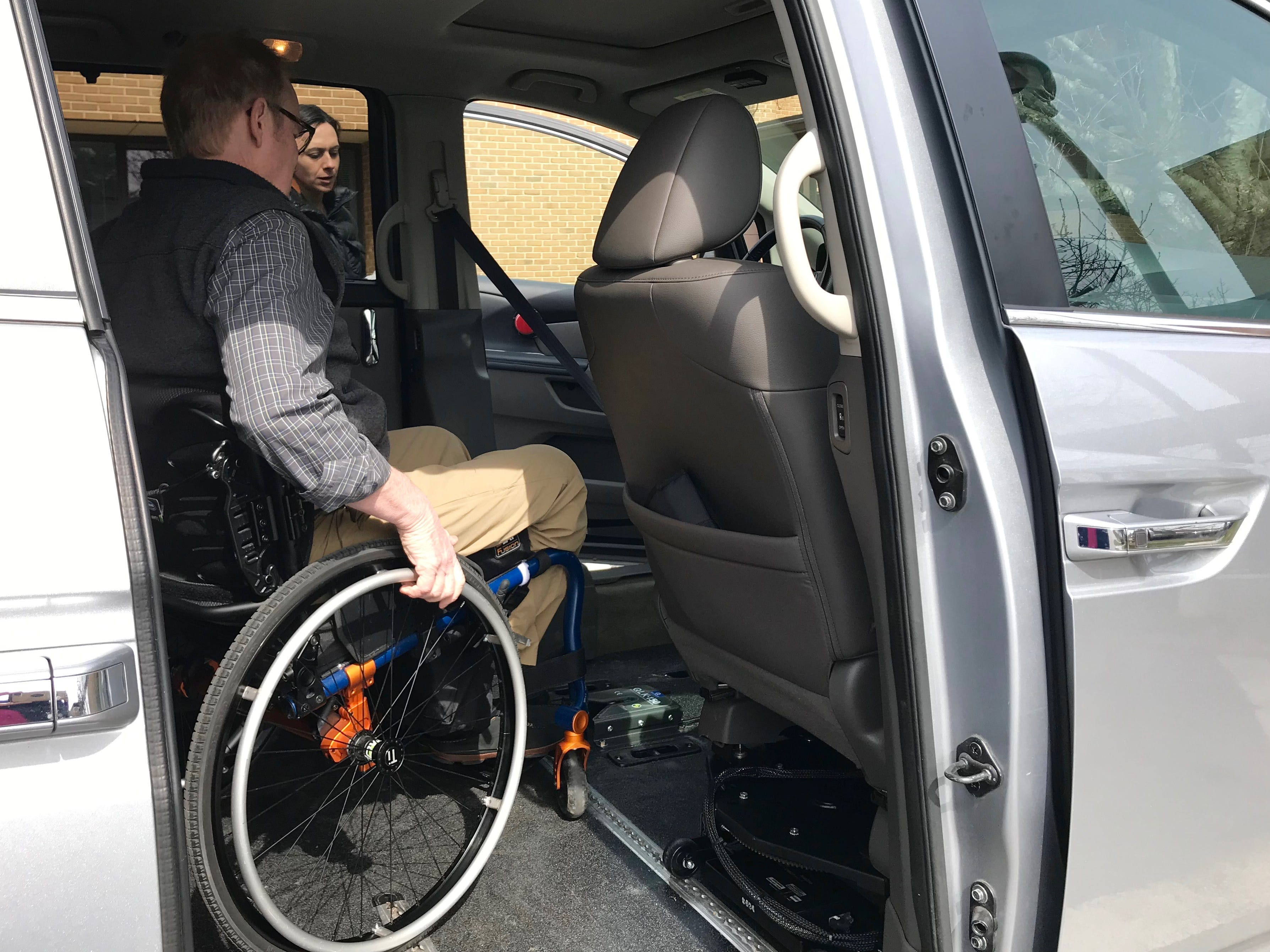 Dr. Robert Kyler receives physical and occupational therapies at Wilson Workforce and Rehabilitation Center in Fishersville. Photographed in the parking lot with Sonya Gasser, occupational therapist, as they evaluate the benefits of owning a handicap-accessible Honda minivan, on Wednesday, March 20, 2019.