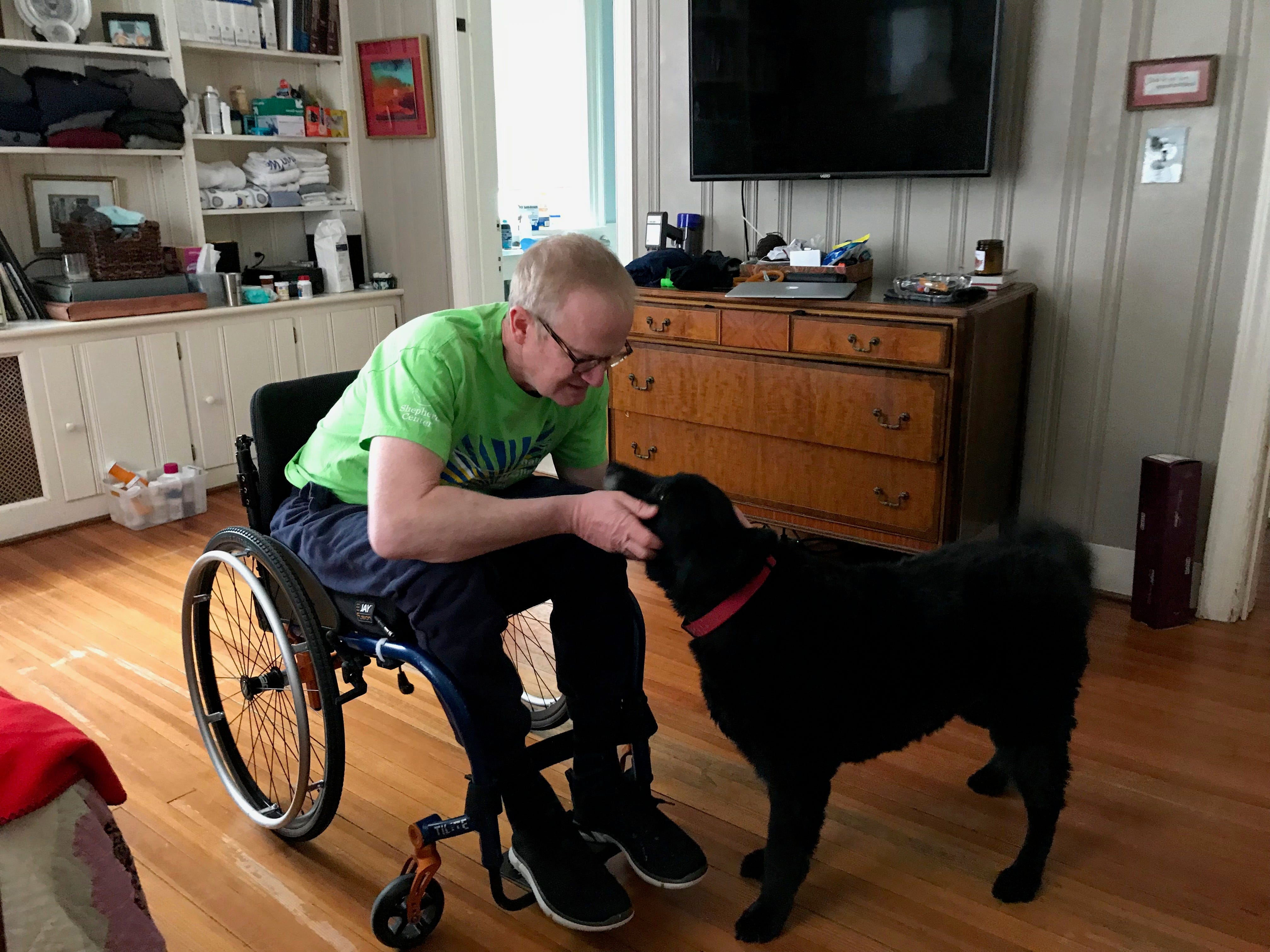 Dr. Robert Kyler with his dog Fritz in his home in Staunton, Virginia, on Friday, March 8, 2019.