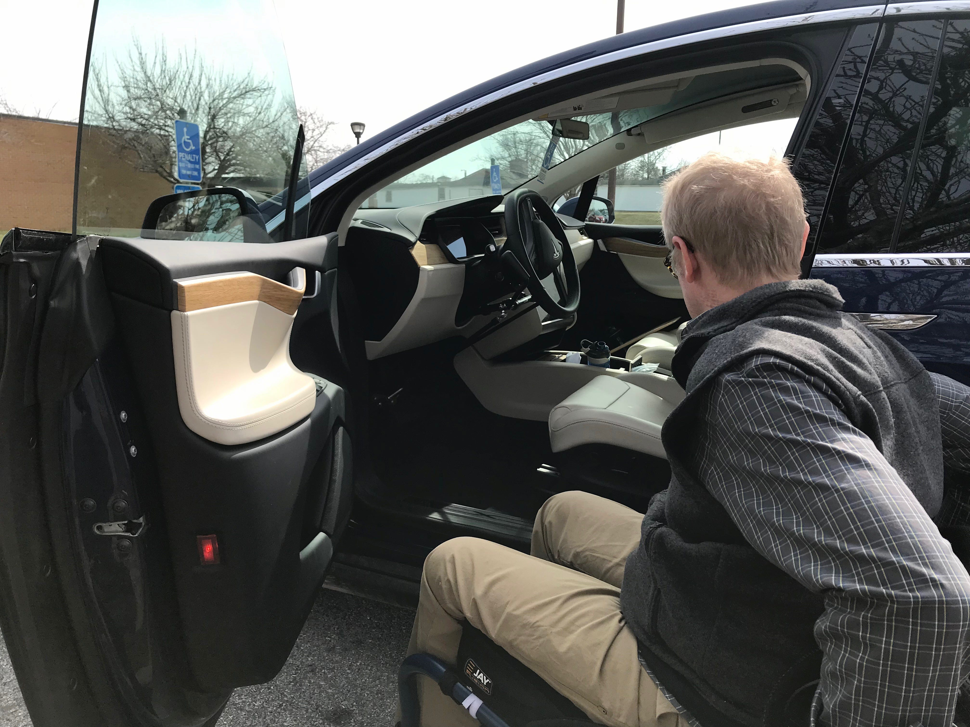 Dr. Robert Kyler receives physical and occupational therapies at Wilson Workforce and Rehabilitation Center in Fishersville. Photographed by his Tesla in the parking lot with Sonya Gasser, occupational therapist (not pictured), on Wednesday, March 20, 2019.