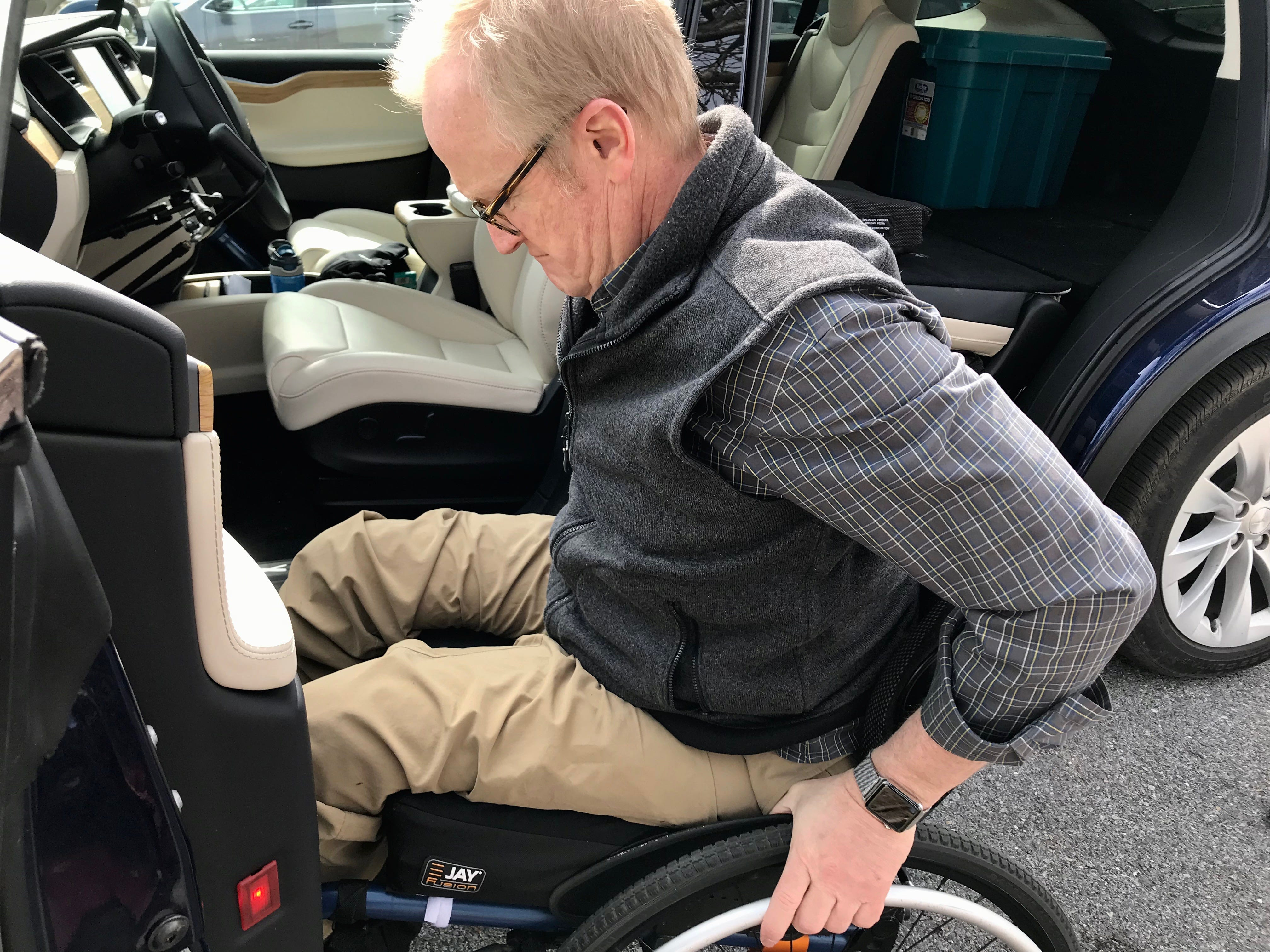 Dr. Robert Kyler receives physical and occupational therapies at Wilson Workforce and Rehabilitation Center in Fishersville. Photographed by his Tesla in the parking lot with Sonya Gasser, occupational therapist, on Wednesday, March 20, 2019.