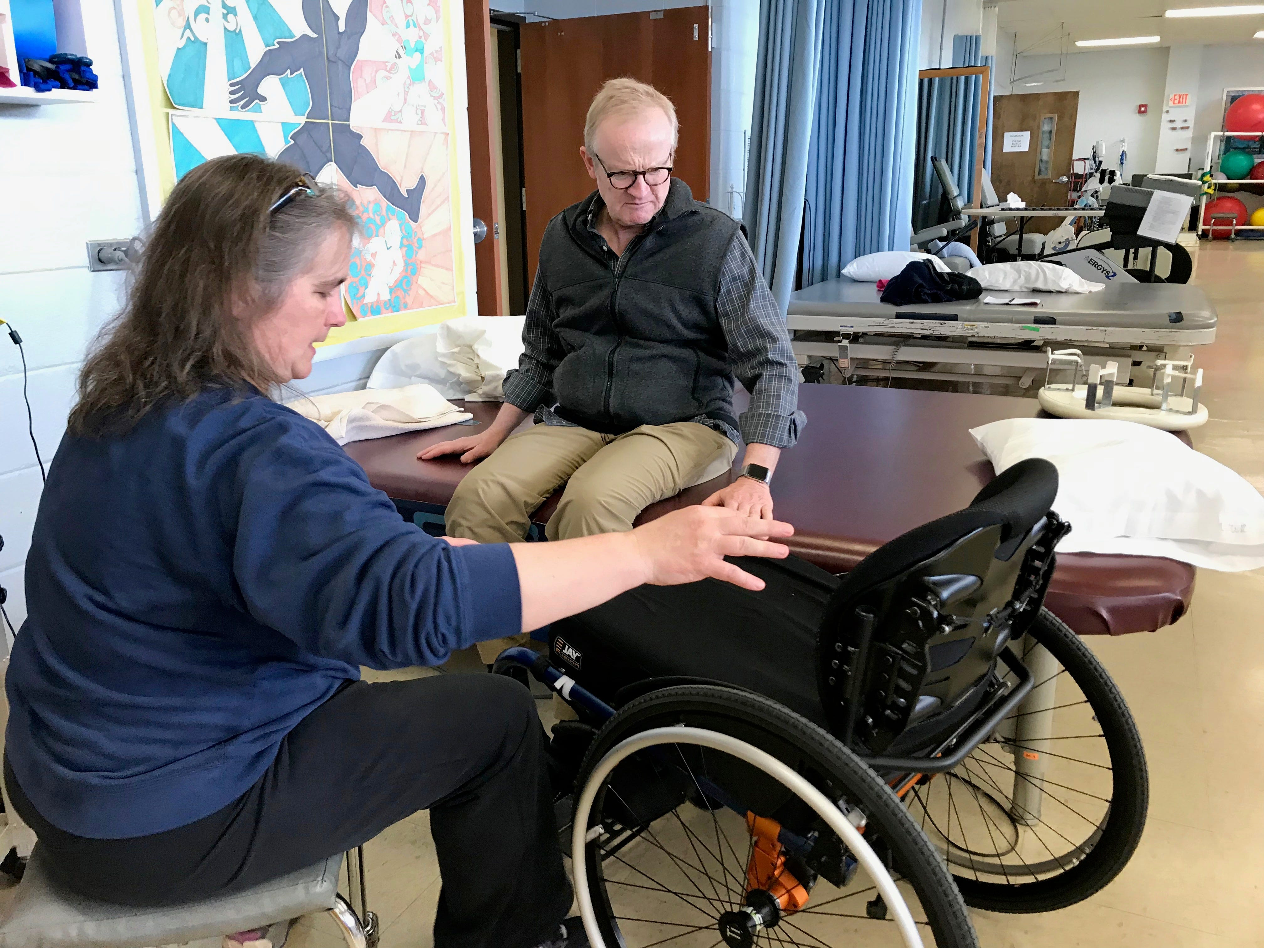 Dr. Robert Kyler receives physical and occupational therapies at Wilson Workforce and Rehabilitation Center in Fishersville. Photographed with Greta Nelson, physical therapist and assistive technology senior, on Wednesday, March 20, 2019.