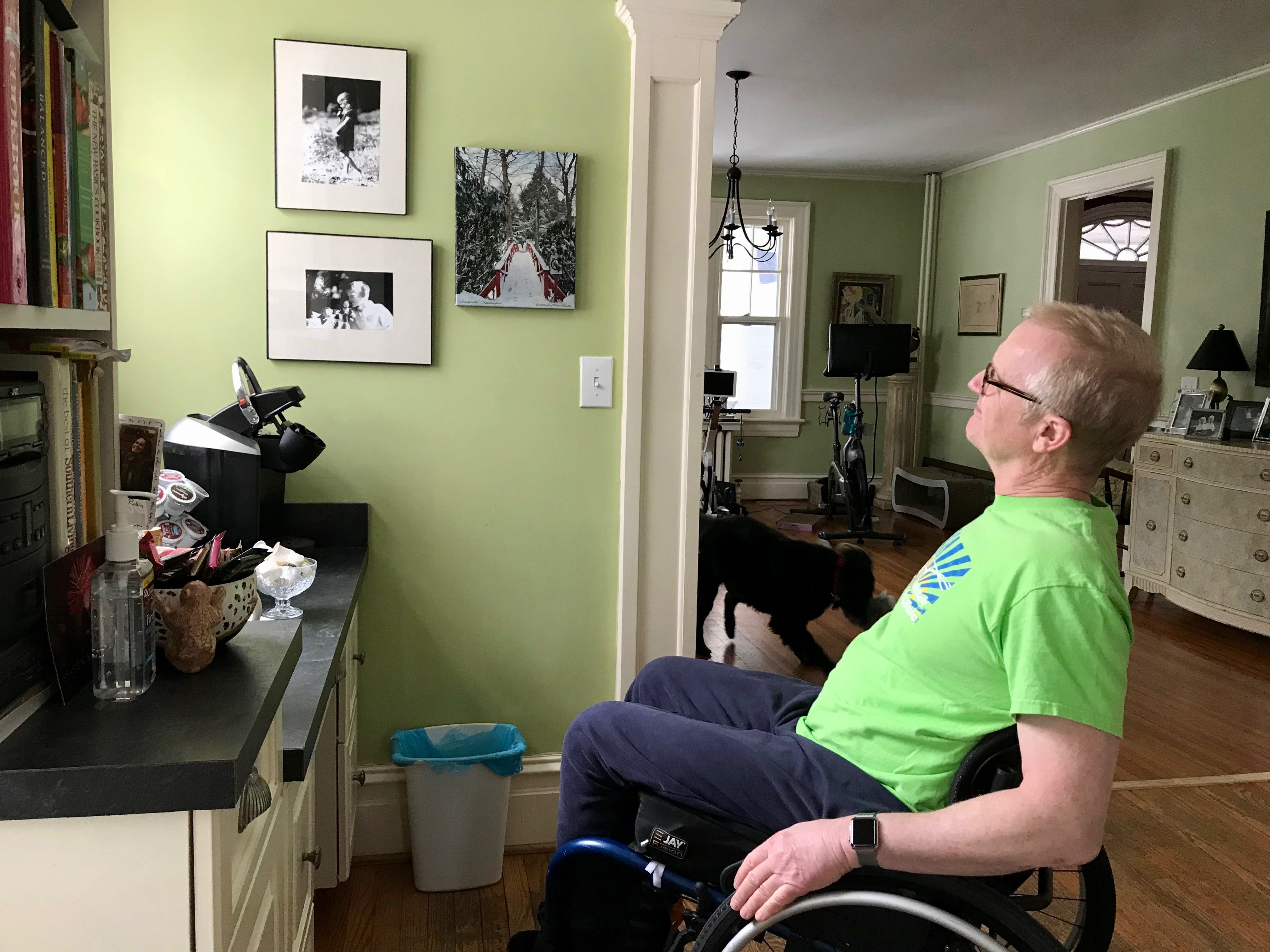 Dr. Robert Kyler in his home in Staunton, Virginia, on Friday, March 8, 2019. Kyler looks at photographs taken of his son and daughter when they were children.
