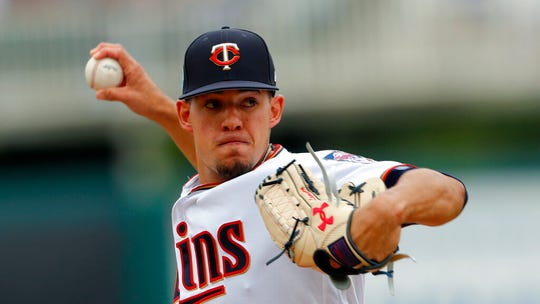 In this Monday, March 18, file photo, Minnesota Twins starting pitcher Jose Berrios works against the Boston Red Sox in the first inning of a spring training baseball game in Fort Myers, Fla.