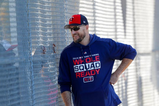 In this Thursday, Feb. 14, file photo, Minnesota Twins manager Rocco Baldelli talks through a fence as pitchers and catchers report for their first workout at their spring training baseball facility in Ft. Myers, Fla.