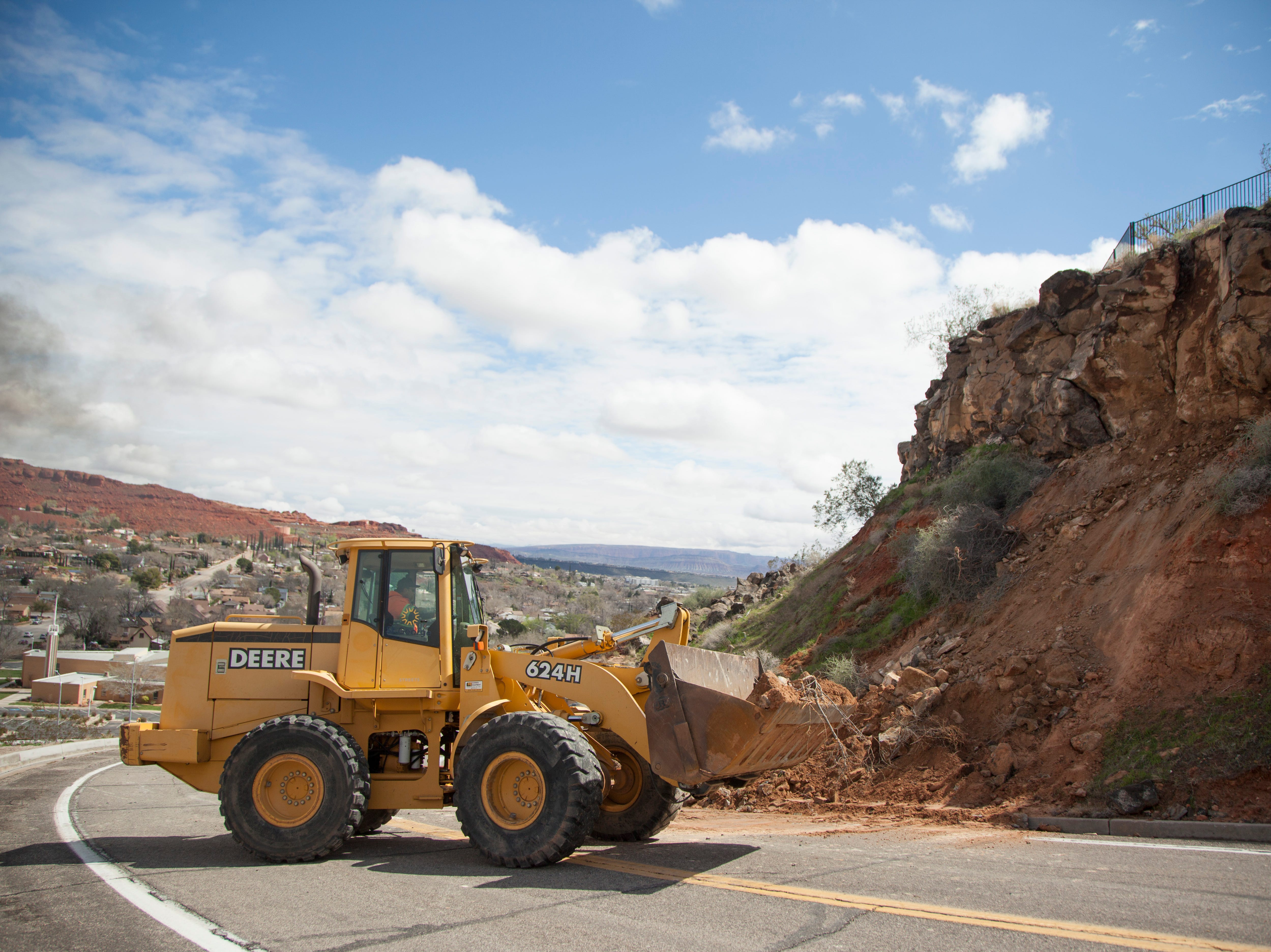 St. George City crews clear a rock slide on 400 North near Donlee Drive Friday, March 22, 2019.