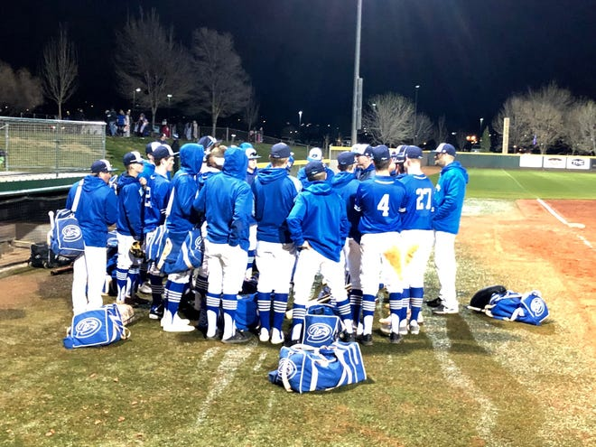 Dixie High baseball players huddle after defeating Snow Canyon 9-6, in a game where the Flyers compiled seven hits, two errors and a broken stadium light.